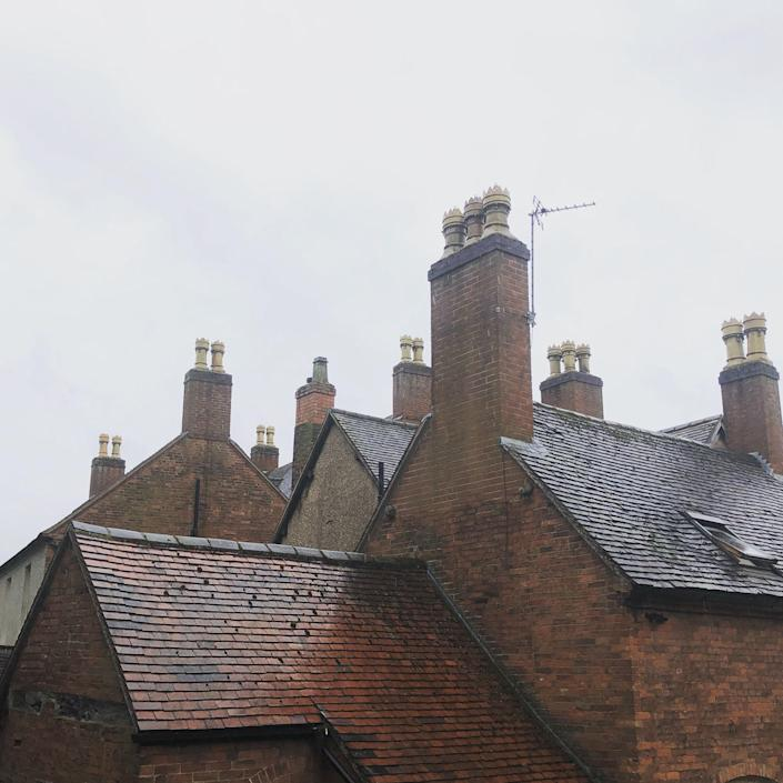 Here, the roofline of the house with its many chimneys—the restoration of which was the one job the couple were happy to give someone else to do.