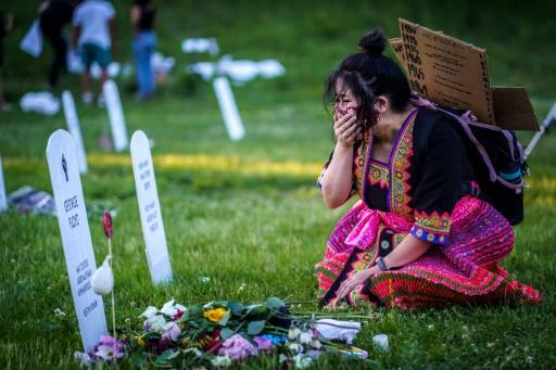 A woman cries in front of an installation created by Anna Barber and Connor Wright called 'Say Their Names' to honor victims of police brutality on June 7, 2020 in Minneapolis