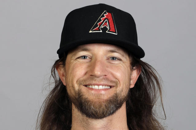 FILE - This is a 2020 photo photo showing Mike Leake of the Arizona Diamondbacks baseball team. Diamondbacks right-hander Mike Leake has opted out of the 2020 season due to concerns about the coronavirus. Diamondbacks general manager Mike Hazen did not elaborate on Leakes decision during a Zoom call, but the pitchers agent issued a statement saying he made a personal decision not to play during the pandemic. (AP Photo/Darron Cummings, File)