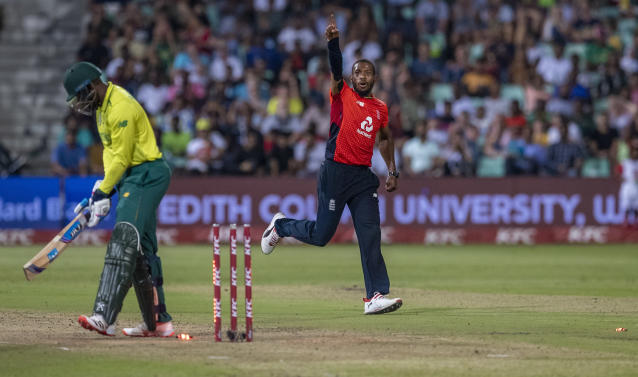 England's bowler Chris Jordan, right, celebrates after bowling South Africa's batsman Andile Phehlukwayo for a duck during the 2nd T20 cricket match between South Africa and England at Kingsmead stadium in Durban, South Africa, Friday, Feb. 14, 2020. (AP Photo/Themba Hadebe)