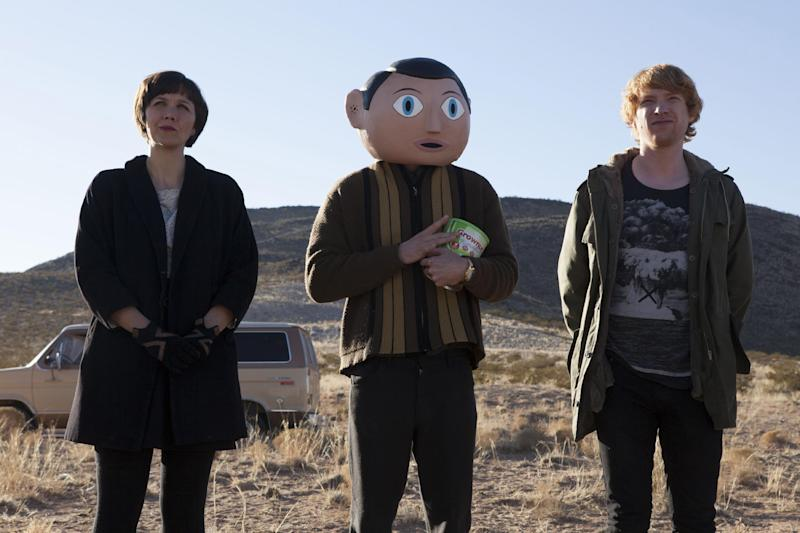 "This photo provided by the Sundance Institute shows, from left, Maggie Gyllenhaal, Michael Fassbender, and Domhnall Gleeson in the film, ""Frank,"" directed by Lenny Abrahamson. The film will have its premiere at the 2014 Sundance Film Festival. The festival runs Jan. 16 - 26, 2014, in Park City, Utah. (AP Photo/Sundance Institute, Lorey Sebastian)"