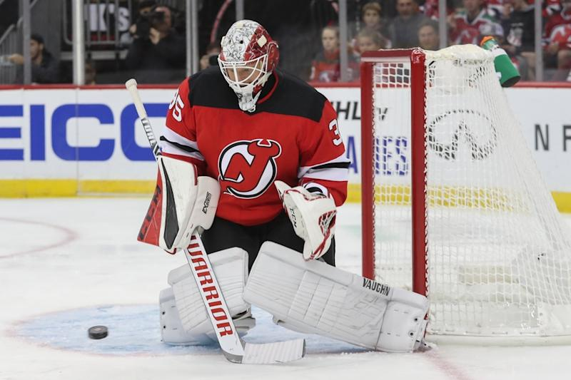 Cory Schneider makes save during Devils game against Panthers