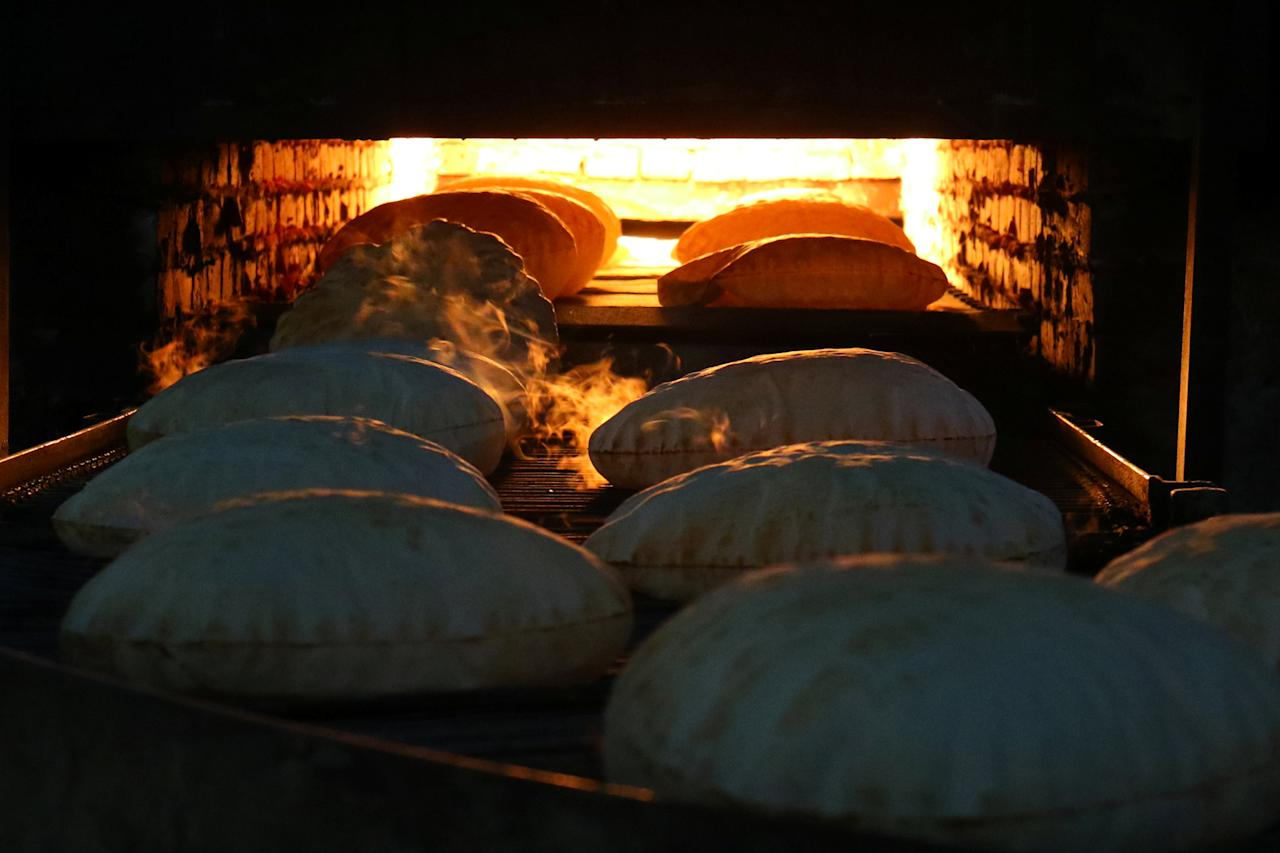 Bread is being baked and to be distributed free among internally displaced people in Salqin town, in Idlib province, Syria March 21, 2017. REUTERS/Ammar Abdullah