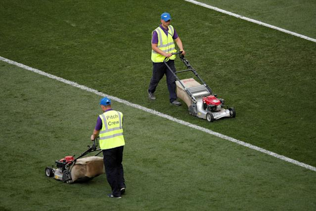 Soccer Football - World Cup - Group B - Portugal vs Morocco - Luzhniki Stadium, Moscow, Russia - June 20, 2018 General view of groundstaff cutting the grass after the match REUTERS/Christian Hartmann