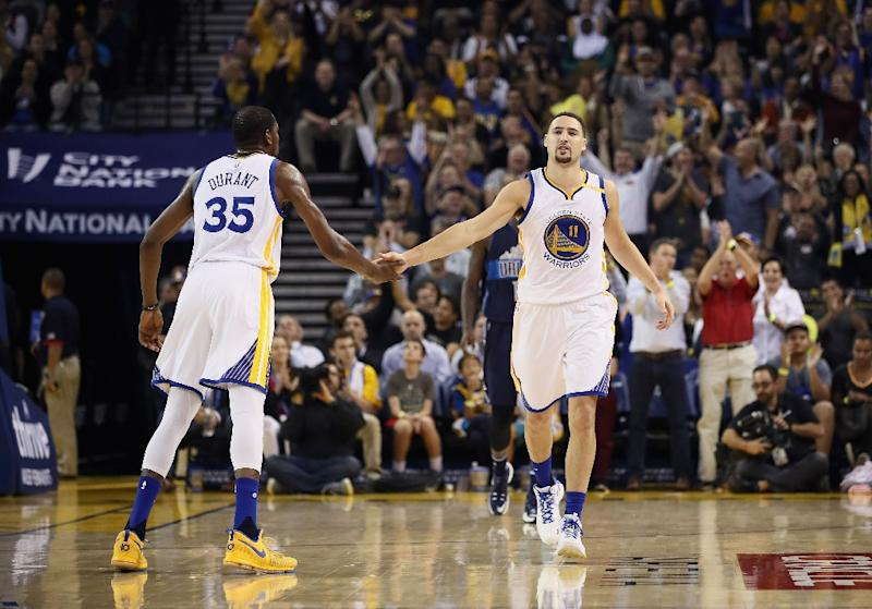 Durant has 33, Warriors hold on for 124-121 win over Bucks