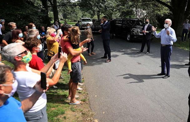 PHOTO: Democratic presidential nominee Joe Biden talks to neighbors who gathered outside his meeting with veterans union leaders in Lancaster, Pa., Sept. 7, 2020. (Chip Somodevilla/Getty Images)