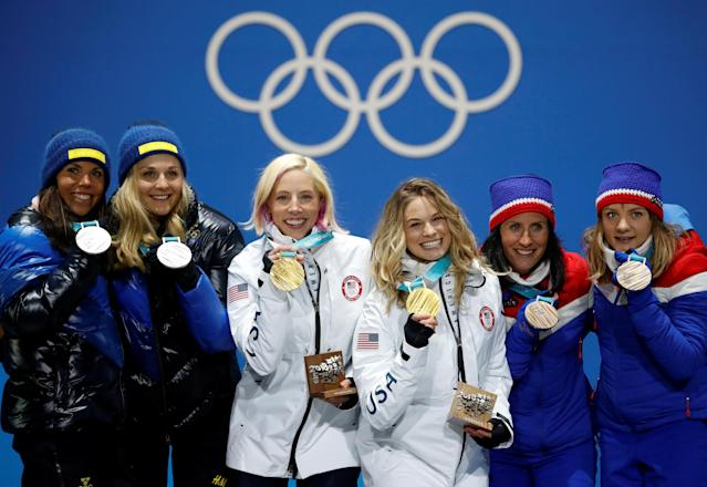 FILE PHOTO: Medals Ceremony - Cross-Country Skiing - Pyeongchang 2018 Winter Olympics - Women's Team Sprint Free - Medals Plaza - Pyeongchang, South Korea - February 22, 2018 - Gold medalists Kikkan Randall and Jessica Diggins of the U.S, silver medalists Charlotte Kalla and Stina Nilsson of Sweden and bronze medalists Marit Bjoergen and Maiken Caspersen Falla of Norway on the podium. REUTERS/Kim Hong-Ji