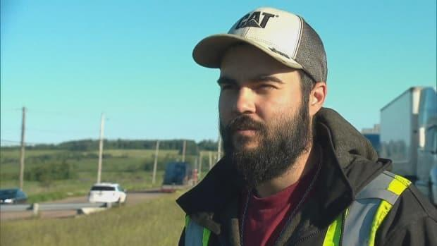 Jessie Bazinet had to park his tractor trailer in Aulac, N.B., and walk across the border on Wednesday to get home because of the protest that halted traffic.  (Radio-Canada - image credit)