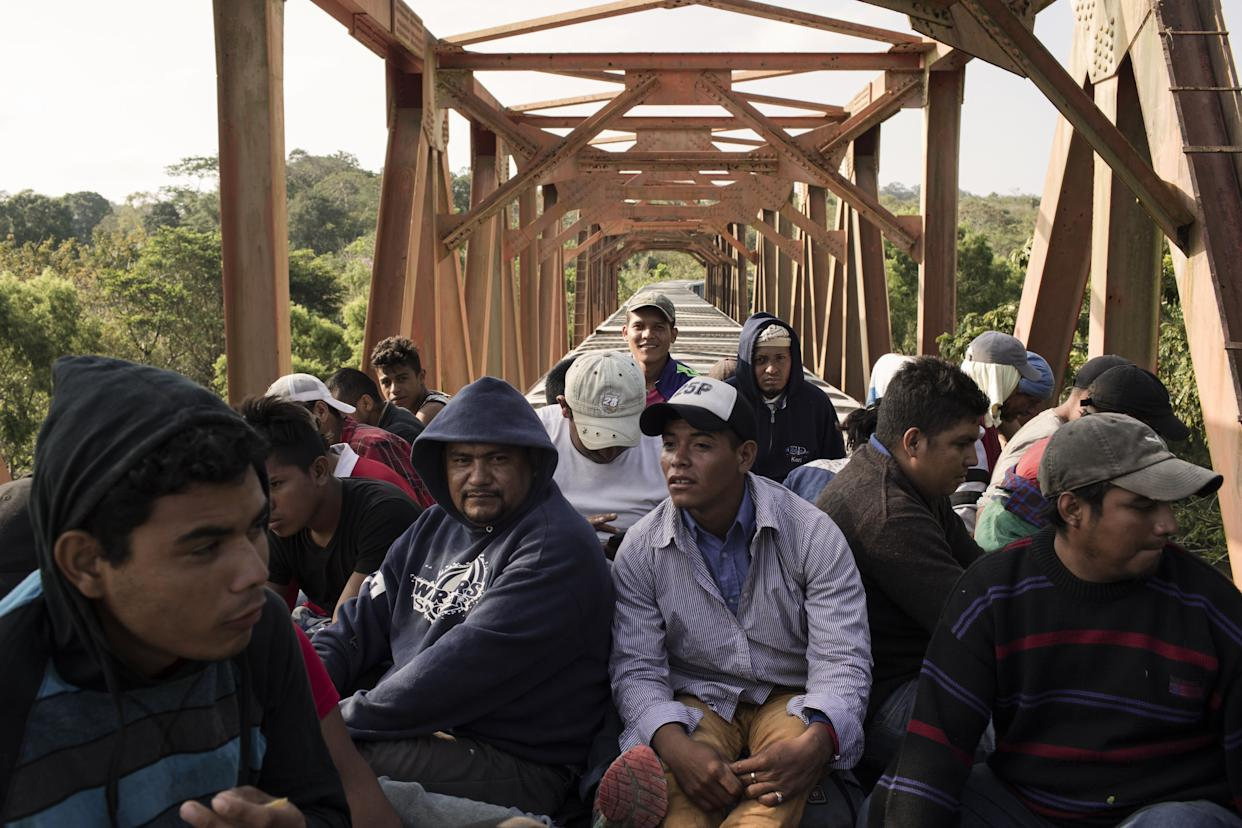 """Central American migrants ride the freight train called """"The Beast"""" in Matias Romero, Mexico, on April 1. (Photo: Jordi Ruiz Cirera/Bloomberg via Getty Images)"""