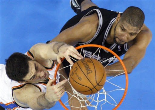 Oklahoma City Thunder forward Nick Collison (4) dunks against San Antonio Spurs center Tim Duncan (21) during the first half of Game 4 in the NBA basketball playoffs Western Conference finals, Saturday, June 2, 2012, in Oklahoma City. (AP Photo/Sue Ogrocki)