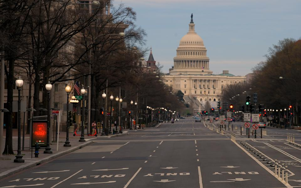 WASHINGTON, DC- MARCH 20: Looking east towards the Capitol Building on a vacant Pennsylvania Avenue at 6:49 pm  due to the coronavirus pandemic in Washington, DC on March 20, 2020 . (Photo by John McDonnell/The Washington Post via Getty Images)