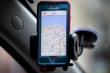 A smartphone app for Lyft drivers is seen during a photo opportunity in San Francisco
