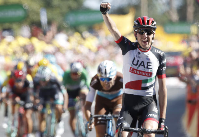 Ireland's Daniel Martin celebrates as he crosses the finish line to win the sixth stage of the Tour de France cycling race over 181 kilometers (112.5 miles) with start in Brest and finish in Mur-de-Bretagne Guerledan, France, Thursday, July 12, 2018. (AP Photo/Christophe Ena )