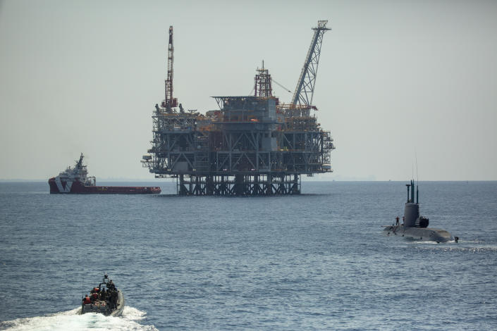 An oil platform in Israel's offshore Leviathan gas field is seen from on board the Israeli Navy Ship Atzmaut as a submarine patrols, in the Mediterranean Sea, Wednesday, Sept. 1, 2021. One of the navy's most important responsibilities is protecting Israel's natural gas platforms in the Mediterranean Sea, which now provide some 75% of the country's electricity. (AP Photo/Ariel Schalit)