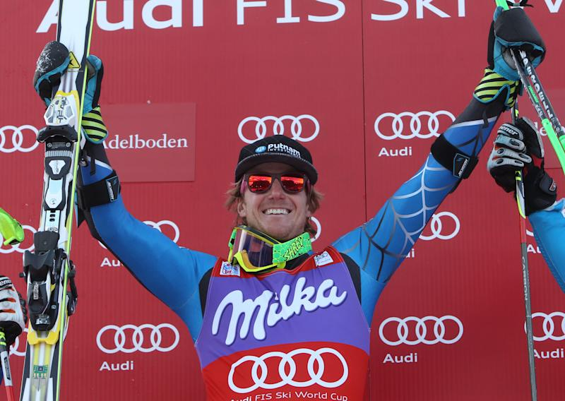 Ted Ligety from the United States celebrates on the podium after winning an alpine ski, men's World Cup giant slalom in Adelboden, Switzerland, Saturday, Jan.12, 2013. (AP Photo/Alessandro Trovati)