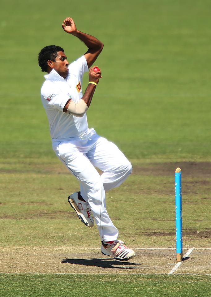 CANBERRA, AUSTRALIA - DECEMBER 06:  Dhammika Prasad of Sri Lanka bowls during day one of the international tour match between the Chairman's XI and Sri Lanka at Manuka Oval on December 6, 2012 in Canberra, Australia.  (Photo by Brendon Thorne/Getty Images)