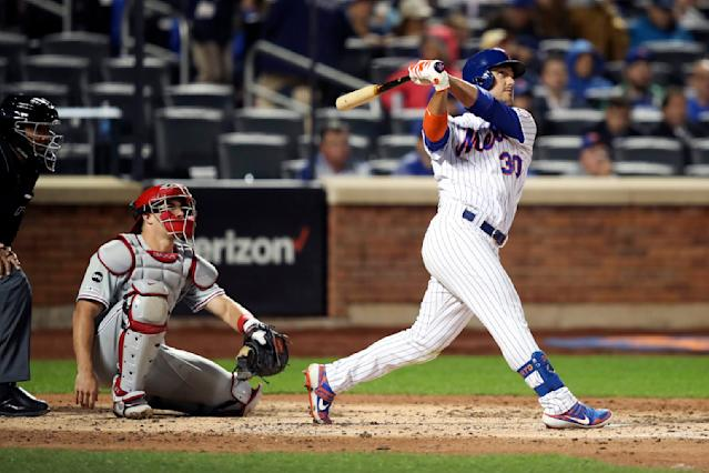 New York Mets' Michael Conforto, right, watches his solo home run during the fourth inning of a baseball game against the Philadelphia Phillies, Friday, Sept. 6, 2019, in New York. (AP Photo/Mary Altaffer)