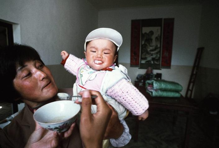 A baby is fed by its mother
