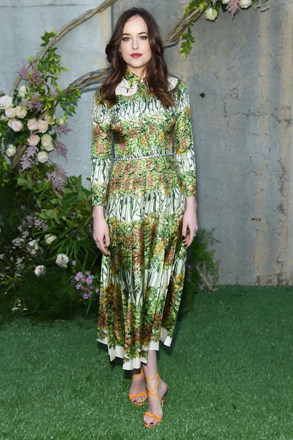 Style Notes: Dakota knows that florals are forever, and often chooses dresses with the motif in striking green hues, which beautifully offset her alabaster skin and dark hair.