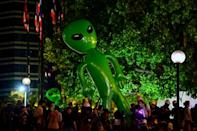 A large inflatable alien is displayed by Thai pro-democracy protesters demanding the king give up control of his multibillion-dollar fortune