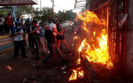 Demonstrators burn the Sandinista radio station during clashes with riot police during a protest against Nicaragua's President Daniel Ortega's government in Managua, May 30. REUTERS/Oswaldo Rivas