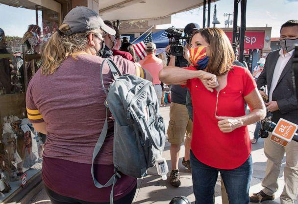 PHOTO: Republican Senator Martha McSally campaigns to keep her seat in the U.S. Senate outside a polling location in Scottsdale, Ariz., Nov. 3, 2020. (Rick D'Elia/EPA-EFE/Shutterstock)