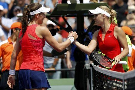 Apr 1, 2017; Key Biscayne, FL, USA; Johanna Konta of Great Britain (L) shakes hands with Caroline Wozniacki of Denmark (R) after their match in the women's singles championship of the 2017 Miami Open at Crandon Park Tennis Center. Mandatory Credit: Geoff Burke-USA TODAY Sports