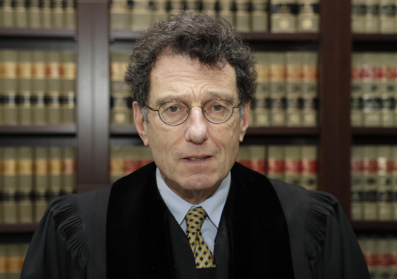 FILE - This Jan. 11, 2018 file photo shows Judge Dan Polster in his office, in Cleveland. Negotiations aimed at reaching a major settlement in the nation's opioid litigation reached an impasse Friday, Oct. 18, 2019. U.S. District Court Judge Polster has said he wants the parties to strike a settlement in such a way that it would make a real difference in resolving the crisis. He invited state attorneys general to participate in the negotiations even though their lawsuits against the industry were filed in state courts. (AP Photo/Tony Dejak, File)