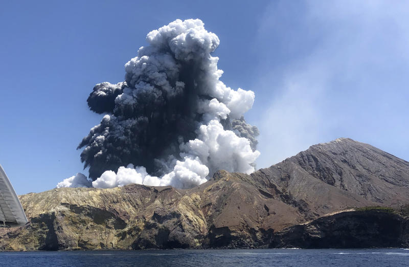 The eruption of the volcano on White Island off the coast of Whakatane, New Zealand is seen.