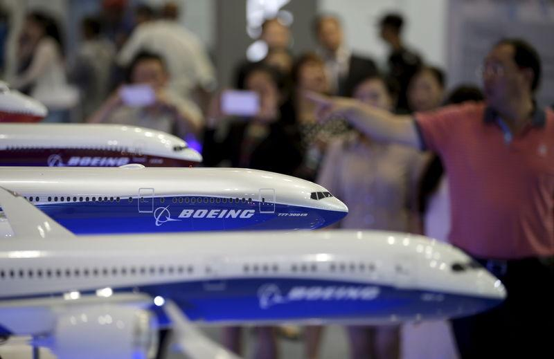 FILE PHOTO - visitors looking at models of Boeing aircrafts at the Aviation Expo China, in Beijing