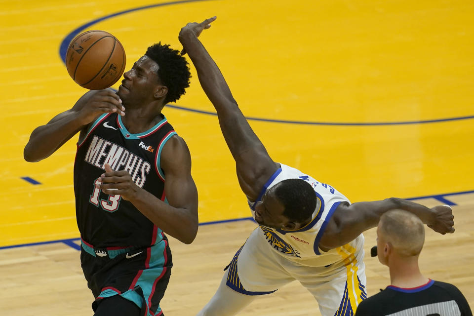 Memphis Grizzlies forward Jaren Jackson Jr. (13) looks for the ball in front of Golden State Warriors forward Draymond Green during the first half of an NBA basketball game in San Francisco, Sunday, May 16, 2021. (AP Photo/Jeff Chiu)