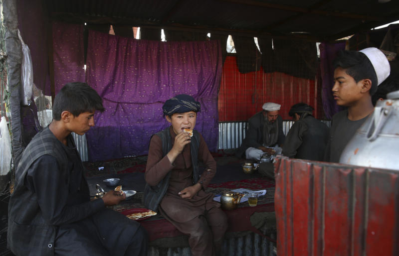 Afghans have breakfast at a local restaurant at a market in Kabul, Afghanistan, Tuesday, Aug. 6, 2019. (AP Photo/Rafiq Maqbool)