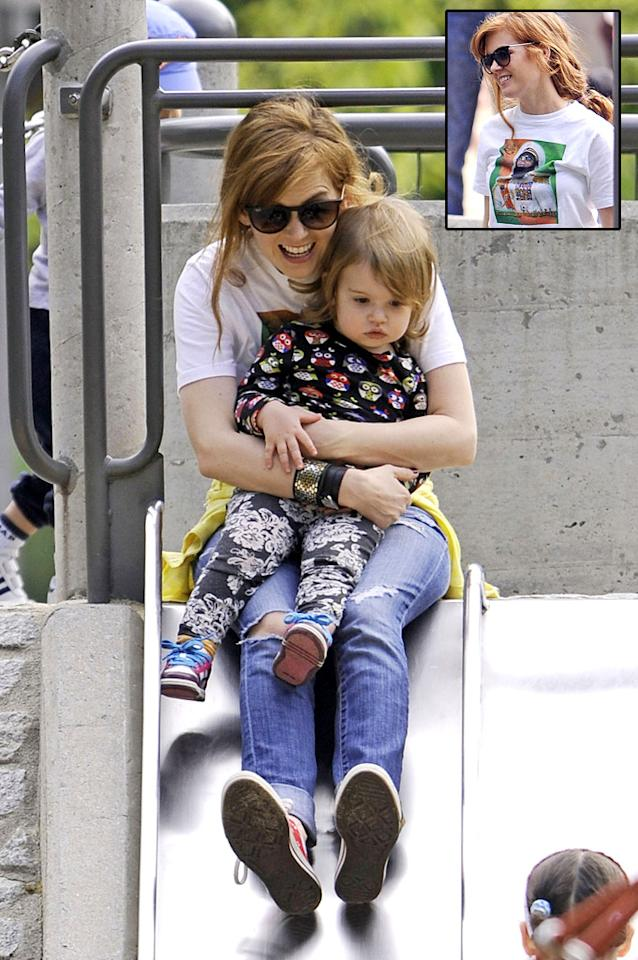"Isla Fisher got in on the fun while visiting a New York City park with her 19-month-old daughter Elula. While at play with her youngest, the actress also gave a shout out to her husband, Sacha Baron Cohen, who has been busy promoting his upcoming film ""The Dictator,"" by wearing a shirt with a photo of his latest character creation. (5/6/2012)"