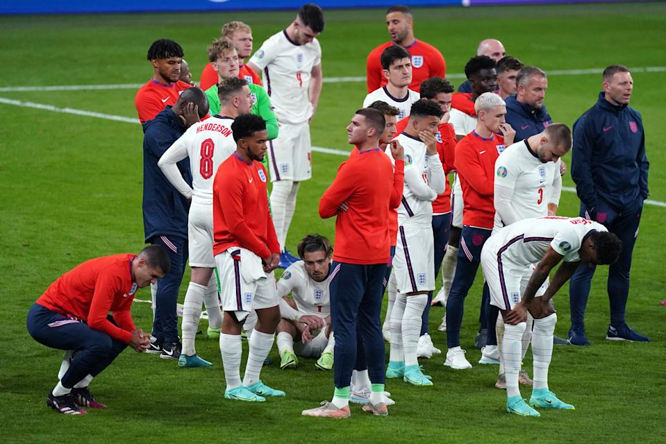 England players stand dejected following the UEFA Euro 2020 Final at Wembley Stadium, London. Picture date: Sunday July 11, 2021.