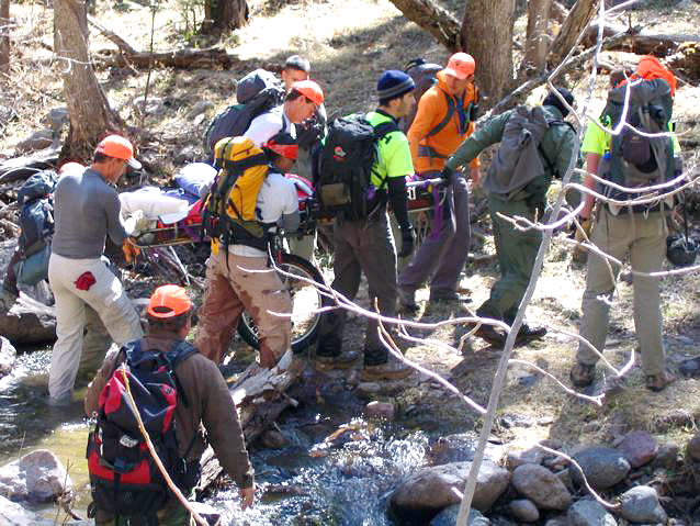 This image provided by David Kuthe shows missing hiker Margaret Page being rescued March 7, 2012 inside the Gila National Forest, N.M. Page who had been missing for nearly a month, was found malnourished and emaciated but well-hydrated. Authorities believed she had probably stayed alive by drinking water from a nearby creek (AP Photo/David Kuthe, Glenn Tolhurst)