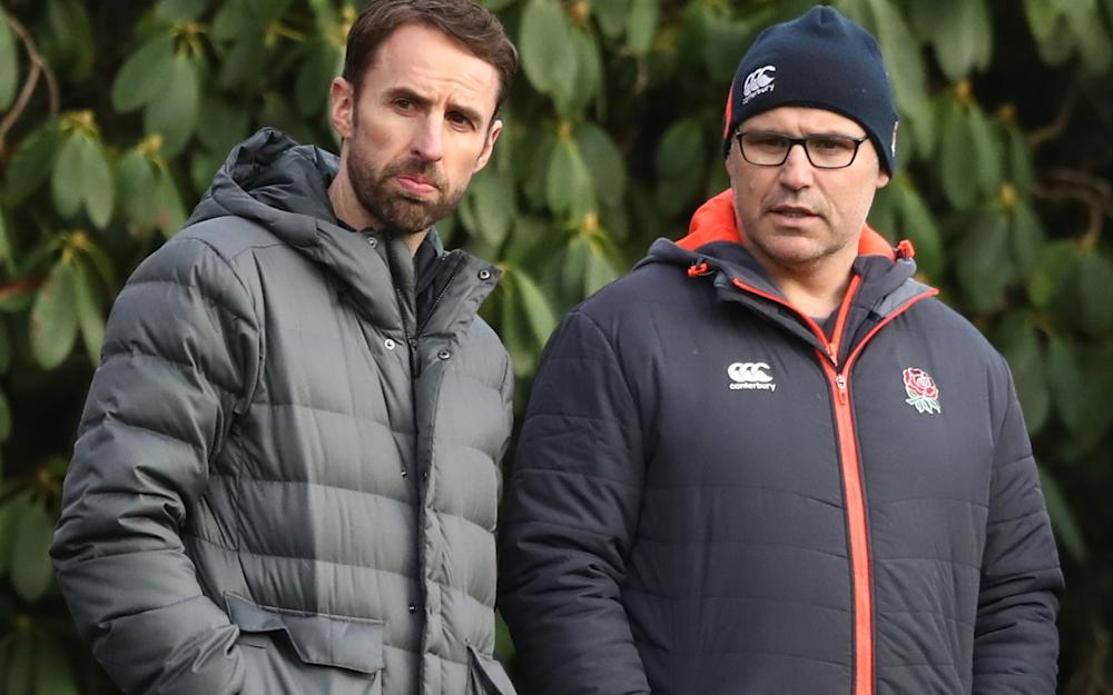 England Football Team Manager chats with John Fletcher of the RFU during the England training session - Credit: Getty Images