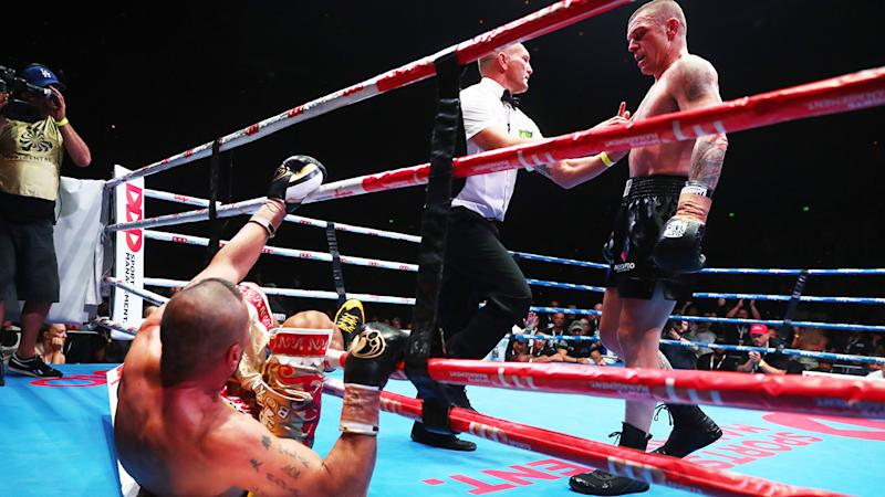 Anthony Mundine was knocked out of the ring by John Wayne-Parr in what could be his final bout. (Photo by Chris Hyde/Getty Images)