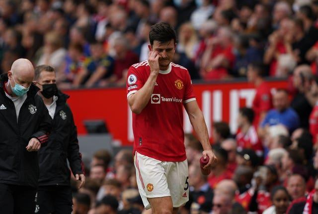 Harry Maguire leaves the pitch after suffering an injury
