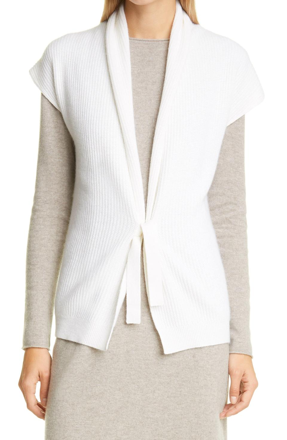"""<p><strong>ALLUDE</strong></p><p>nordstrom.com</p><p><strong>$350.00</strong></p><p><a href=""""https://go.redirectingat.com?id=74968X1596630&url=https%3A%2F%2Fwww.nordstrom.com%2Fs%2Fallude-rib-tie-front-sweater-vest%2F5735217&sref=https%3A%2F%2Fwww.townandcountrymag.com%2Fstyle%2Ffashion-trends%2Fg34521550%2Fbest-sweater-vests%2F"""" rel=""""nofollow noopener"""" target=""""_blank"""" data-ylk=""""slk:Shop Now"""" class=""""link rapid-noclick-resp"""">Shop Now</a></p>"""