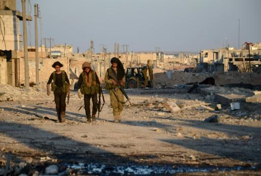 Suicide bomber kills 29 near Syria town taken from IS