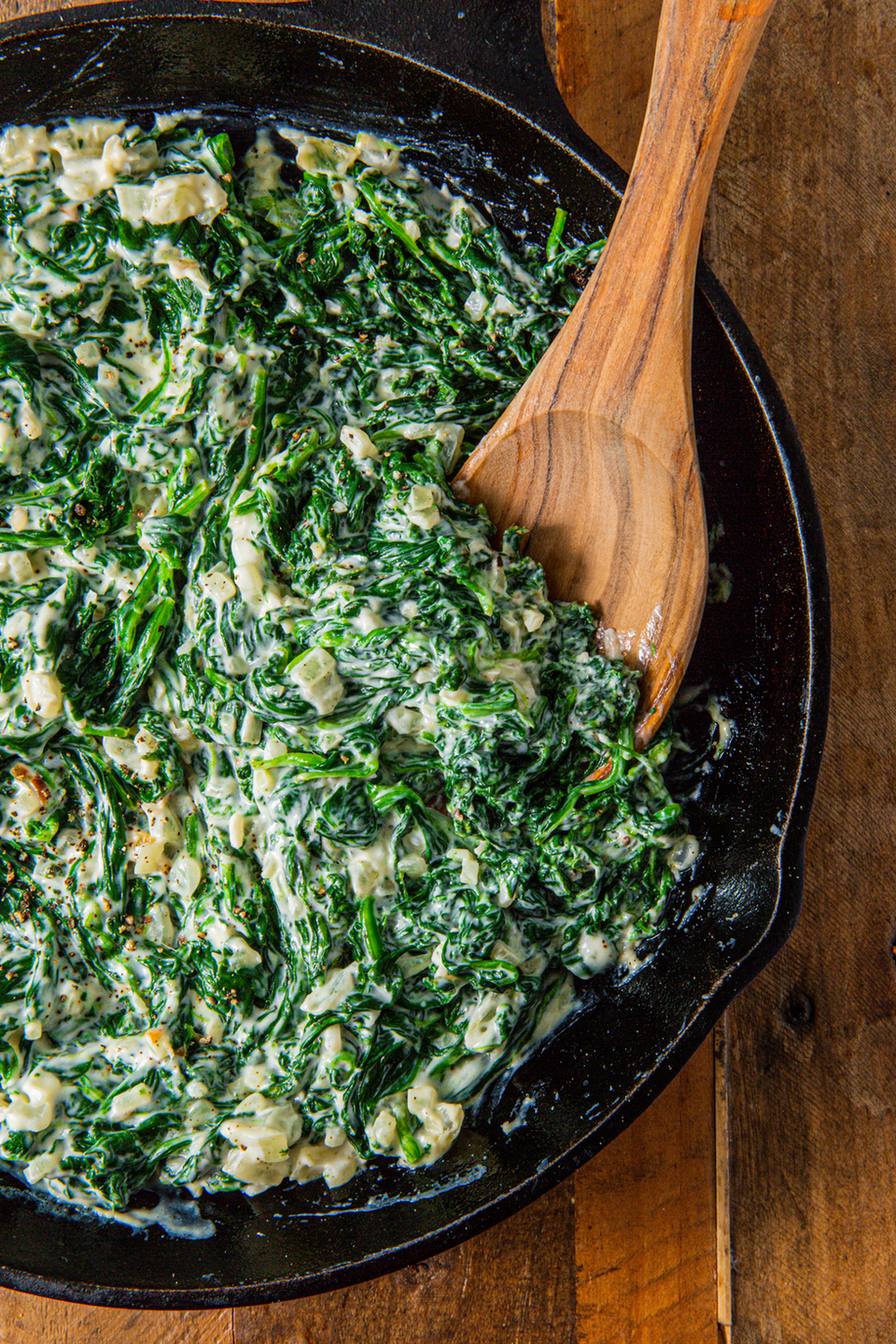 """<p>Creamed spinach is a simple side dish that is also the perfect way to use up any dying spinach. The creaminess will make you forget you're eating spinach and make everyone a fan. It seems like a lot of spinach, but it will boil down into almost nothing so don't skimp on it. </p><p>Get the <a href=""""https://www.delish.com/uk/cooking/recipes/a30425708/easy-creamed-spinach-recipe/"""" rel=""""nofollow noopener"""" target=""""_blank"""" data-ylk=""""slk:Creamed Spinach"""" class=""""link rapid-noclick-resp"""">Creamed Spinach</a> recipe. </p>"""