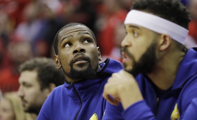 Golden State Warriors forward Kevin Durant, left, sits on the bench during the second half in Game 2 of the NBA basketball Western Conference Finals against the Houston Rockets, Wednesday, May 16, 2018, in Houston. (AP Photo/David J. Phillip)