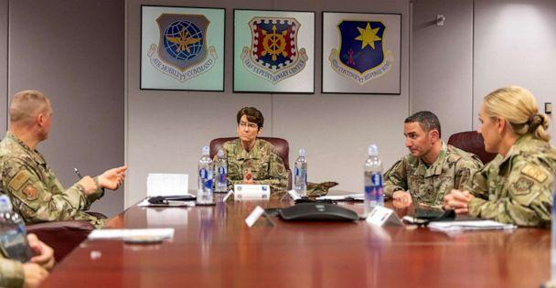PHOTO: Gen. Jacqueline Van Ovost, Air Mobility Command commander, listens to Col. Doug Jackson, 621st Contingency Response Wing commander, about the wing mission, Aug. 31, 2020, on Travis Air Force Base, Calif. (Tech. Sgt. David W. Carbajal/621st Contingency Response Wing )