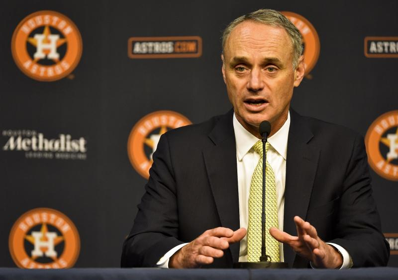 MLB Commissioner Rob Manfred speaks to the media before a baseball game between the Houston Astros and the Detroit Tigers, Tuesday, May 23, 2017, in Houston. Manfred is in Houston to participate in the B.A.T. ceremony honoring former MLB player Bob Watson with its lifetime achievement award. (AP Photo/Eric Christian Smith)