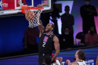 Los Angeles Clippers forward Kawhi Leonard (2) scores against the Denver Nuggets during the first half of an NBA conference semifinal playoff basketball game Tuesday, Sept. 15, 2020, in Lake Buena Vista, Fla. (AP Photo/Mark J. Terrill)