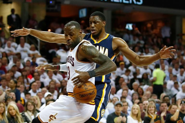 LeBron James of the Cleveland Cavaliers controls the ball in front of Thaddeus Young of the Indiana Pacers in Game Two of the Eastern Conference quarter-finals during the 2017 NBA Playoffs, at Quicken Loans Arena in Cleveland, Ohio, on April 17