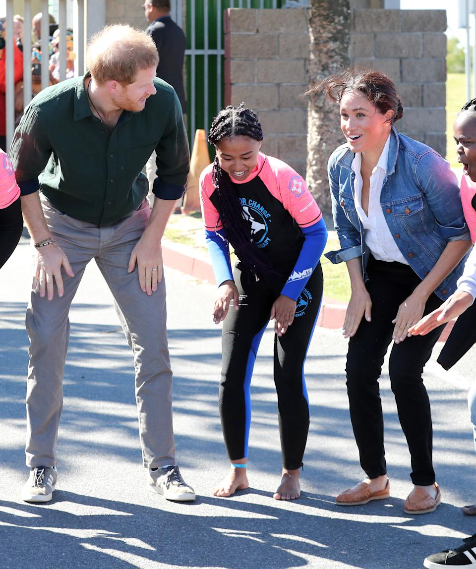 Prince Harry looked stylish as he paired his smart casj look with a pair of Adidas Gazelles [Photo: Getty Images]