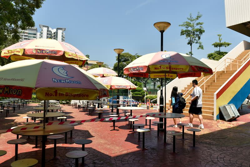 FILE PHOTO: Seating area at a food centre is cordoned off as measures to curb the COVID-19 outbreak in Singapore