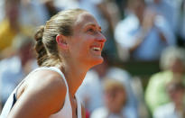 FILE- In this June 2, 2005, file photo France's Mary Pierce smiles as she plays Russia's Ellena Likhovtseva during their semifinal match of the French Open tennis tournament, at the Roland Garros stadium in Paris. Pierce joins Yevgeny Kafelnikov and Li Na in the International Tennis Hall of Fame Class of 2019, which was announced Monday, Jan. 21, 2019, at the Australian Open. (AP Photo/Lionel Cironneau, File)