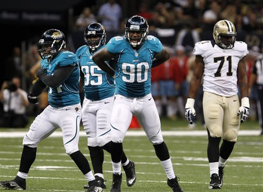 Jacksonville Jaguars defensive end Jeremy Mincey (94), defensive tackle D'Anthony Smith (95) and defensive end Andre Branch (90) celebrate after sacking New Orleans Saints quarterback Chase Daniel (not shown) in the first half of a preseason NFL football game in New Orleans, Friday, Aug. 17, 2012. Saints offensive tackle Charles Brown (71) looks on. (AP Photo/Jonathan Bachman)